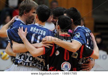 KAPOSVAR, HUNGARY - MARCH 22: Kaposvar players celebrate a score at a Hungarian National Championship volleyball game Kaposvar vs. Veszprem, March 22, 2010 in Kaposvar, Hungary.