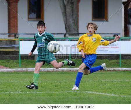 KAPOSVAR, HUNGARY - APRIL 10: Soma Ozorai (L) in action at the Hungarian National Championship under 13 game between Kaposvar and Siofok April 10, 2010 in Kaposvar, Hungary.