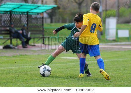 KAPOSVAR, HUNGARY - APRIL 10: Soma Ozorai (in green) in action at the Hungarian National Championship under 13 game between Kaposvar and Siofok April 10, 2010 in Kaposvar, Hungary.