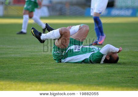 KAPOSVAR, HUNGARY - APRIL 17: Junior lies on the ground at a Hungarian National Championship soccer game Kaposvar vs MTK Budapest April 17, 2010 in Kaposvar, Hungary.