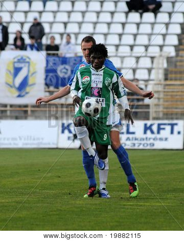 KAPOSVAR, HUNGARY - APRIL 17: Godslove Egejuru (in green) in action at a Hungarian National Championship soccer game Kaposvar vs MTK Budapest April 17, 2010 in Kaposvar, Hungary.