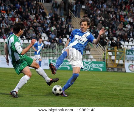KAPOSVAR, HUNGARY - APRIL 17: Uidentified players in action at a Hungarian National Championship soccer game Kaposvar vs MTK Budapest April 17, 2010 in Kaposvar, Hungary.