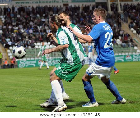 KAPOSVAR, HUNGARY - APRIL 17: Maroti (L) and Szabo (R) in action at a Hungarian National Championship soccer game Kaposvar vs MTK Budapest April 17, 2010 in Kaposvar, Hungary.