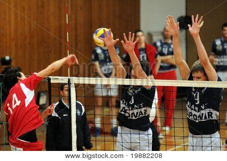 KAPOSVAR, HUNGARY - APRIL 18: Bence Bagics (L) strikes the ball at a Hungarian National Championship Final volleyball game Kaposvar vs. Kecskemet, April 18, 2010 in Kaposvar, Hungary.