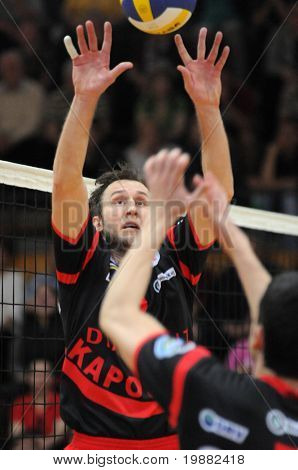 KAPOSVAR, HUNGARY - APRIL 24: Robert Koch (L) posts the ball at a Hungarian National Championship Final volleyball game Kaposvar vs. Kecskemet, April 24, 2010 in Kaposvar, Hungary.