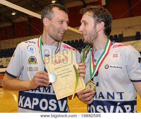 KECSKEMET, HUNGARY - APRIL 27: Kantor (L) and Koch (R) celebrate the win at a Hungarian National Championship Final volleyball game Kecskemet vs. Kaposvar, April 27, 2010 in Kecskemet, Hungary.