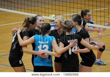 KAPOSVAR, HUNGARY - APRIL 13: Miskolc players celebrate a score at the Hungarian NB I. League woman volleyball game Kaposvar vs Miskolc, April 13, 2010 in Kaposvar, Hungary.