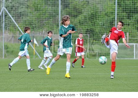KAPOSVAR, HUNGARY - MAY 9: Unidentified palyers in action at the Hungarian National Championship under 15 game between Kaposvari Rakoczi and Nagykanizsa May 9, 2010 in Kaposvar, Hungary.