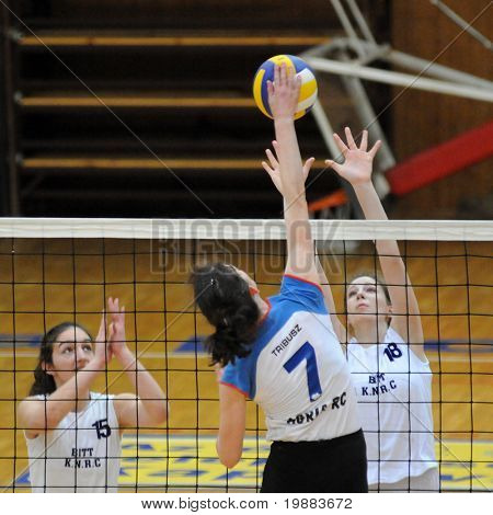 KAPOSVAR, HUNGARY - MARCH 21: Horvath (L) and Rak (R) blocks the ball at the Hungarian NB I. League woman volleyball game Kaposvar vs. Eger, March 21, 2010 in Kaposvar, Hungary.