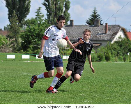 KAPOSVAR, HUNGARY - MAY 29: Andras Strublics (R) in action at the Hungarian National Championship under 19 game between Kaposvari Rakoczi and Barcsi FC May 29, 2010 in Kaposvar, Hungary.