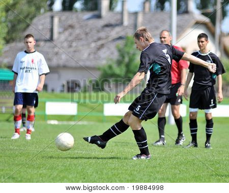 KAPOSVAR, HUNGARY - MAY 29: Andras Strublics (5) in action at the Hungarian National Championship under 19 game between Kaposvari Rakoczi and Barcsi FC May 29, 2010 in Kaposvar, Hungary.