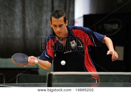 KAPOSVAR, HUNGARY - MAY 8: Unidentified player in action at a Hungarian National Championship III. table tennis game Kaposvar vs. Kozarmisleny May 8, 2010 in Kaposvar, Hungary.
