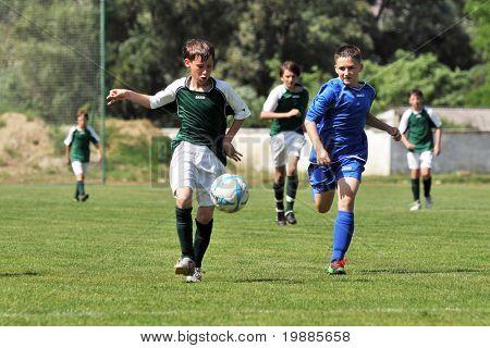 KAPOSVAR, HUNGARY - JUNE 12: Armin Prukner (L) in action at the Hungarian National Championship under 13 game between Kaposvari Rakoczi and Tatabanya June 12, 2010 in Kaposvar, Hungary.