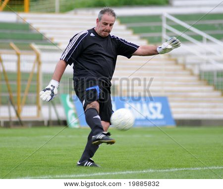 KAPOSVAR,  HUNGARY - JUNE 19: Imre Biro in action at a Somogy County Championship II. final game Labod vs. Sagvar - June 19, 2010 in Kaposvar, Hungary.