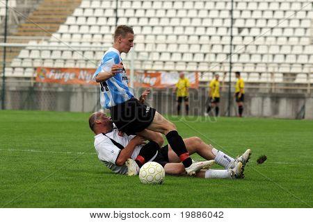 KAPOSVAR, HUNGARY - JUNE 19: Attila Nagy (in blue) in action at a Somogy County Championship II. final game Balatonszabadi vs. Nemesvid - June 19, 2010 in Kaposvar, Hungary.