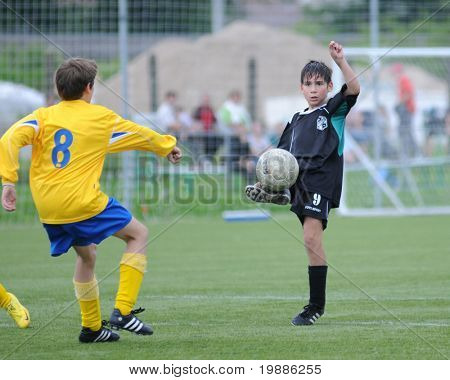 KAPOSVAR, HUNGARY - JUNE 5: Soma Ozorai (R) in action at the Hungarian National Championship under 13 game between Kaposvari Rakoczi and Siofok B June 5, 2010 in Kaposvar, Hungary.