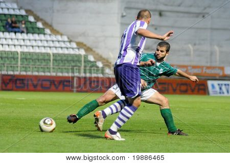 KAPOSVAR, HUNGARY - AUGUST 6: Pedro Sass (in green) in action at a Hungarian National Championship soccer game Kaposvar vs. Ujpest August 6, 2010 in Kaposvar, Hungary.