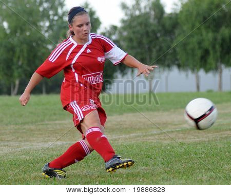 KAPOSVAR, HUNGARY - JULY 20: Unidentified player in action at a VI. Youth Football Festival match Olympia Bruntal (CZE) vs. Nagybajom (HUN)- July 20, 2010 in Kaposvar, Hungary