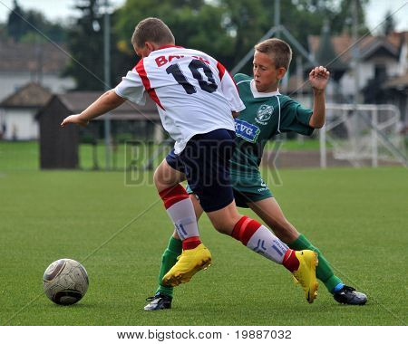 KAPOSVAR, HUNGARY - SEPTEMBER 4: Akos Veto (R) in action at the Hungarian National Championship under 13 game between Kaposvari Rakoczi and Barcs September 4, 2010 in Kaposvar, Hungary.
