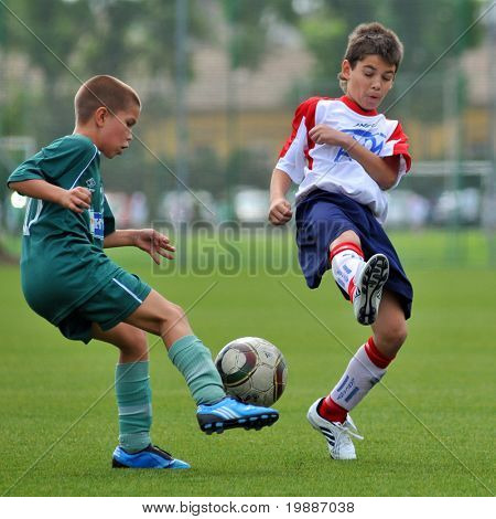KAPOSVAR, HUNGARY - SEPTEMBER 4: Oliver Kiraly (L) in action at the Hungarian National Championship under 13 game between Kaposvari Rakoczi and Barcs September 4, 2010 in Kaposvar, Hungary.