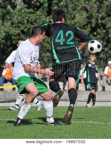 KAPOSVAR, HUNGARY - SEPTEMBER 5: Gergely Balogh (R) in action at a Hungarian National Championship III. soccer game Kaposvar II. vs. Nagyatad September 5, 2010 in Kaposvar, Hungary.