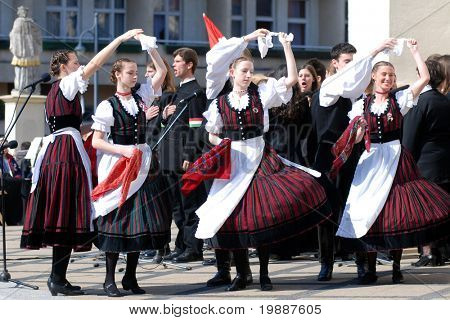 KAPOSVAR, HUNGARY - MARCH 15: Folk dancers dancing at commemoration of 159nd anniversary of the Hungarian Revolution on 15th of March, 2007 in Kaposvar, Hungary