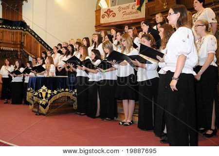 KAPOSVAR, HUNGARY - AUGUST 26: Members of the Kodaly Zoltan Grammar School Choir sing at the IV. Pannonia Cantat Youth Choir Festival August 26, 2010 in Kaposvar, Hungary