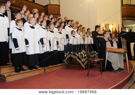 KAPOSVAR, HUNGARY - AUGUST 26: Members of the St Michael's boys Choir (EST) sing at the IV. Pannonia Cantat Youth Choir Festival August 26, 2010 in Kaposvar, Hungary