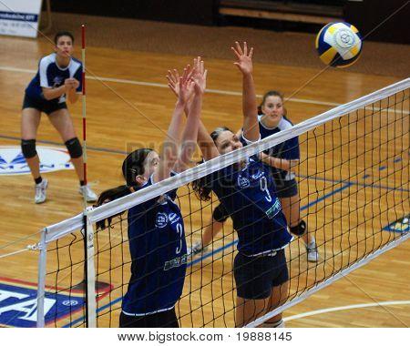 KAPOSVAR, HUNGARY - MARCH 3: Barbara Balajcza (9) blocks the ball at the Hungarian Cup woman volleyball game Kaposvar vs. Vasas, March 3, 2007 in Kaposvar, Hungary.