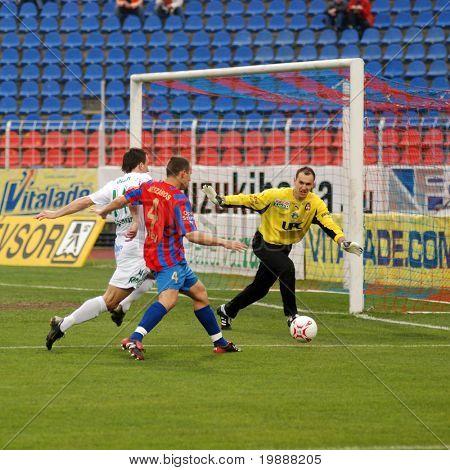 SZEKESFEHERVAR, HUNGARY - MARCH 17: Lorant Olah (L) in action at a Hungarian National Championship soccer game Kaposvar vs. FC Fehervar March 17, 2007 in Szekesfehervar, Hungary.
