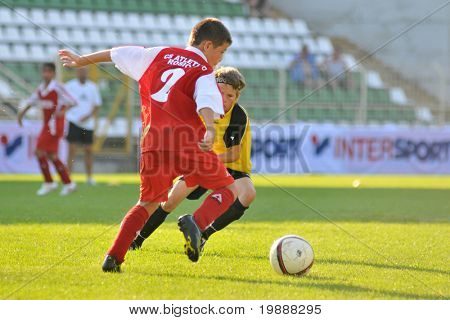 KAPOSVAR, HUNGARY - JULY 23: Unidentified players in action at the VI. Youth Football Festival Under 11 Final FK Novi Grad (BOS) vs. Atletico Rosiori (ROM) July 23, 2010 in Kaposvar, Hungary