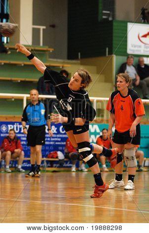 KAPOSVAR, HUNGARY - MAY 18: Dora Karsai (in black) in action at Hungarian Handball National Championship I/B. match (Nagyatad vs. Szombathely) May 18, 2007 in Kaposvar, Hungary.