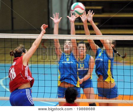 KAPOSVAR, HUNGARY - OCTOBER 3: Pinter (2) and Harmath (3) blocks the ball at the Hungarian NB I. League woman volleyball game Kaposvar vs Szolnok, October 3, 2010 in Kaposvar, Hungary.