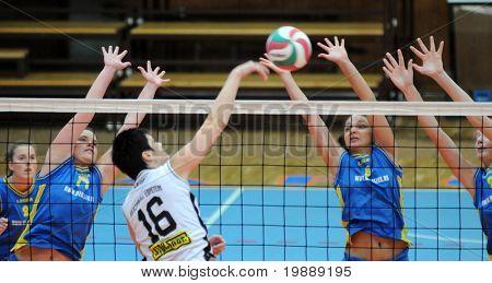 KAPOSVAR, HUNGARY - OCTOBER 10: Barbara Balajcza (8) blocks the ball at the Hungarian NB I. League woman volleyball game Kaposvar vs Veszprem, October 10, 2010 in Kaposvar, Hungary.
