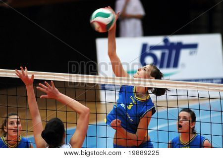 KAPOSVAR, HUNGARY - OCTOBER 10: Zsofia Harmath (2nd from R) in action at the Hungarian NB I. League woman volleyball game Kaposvar vs Veszprem, October 10, 2010 in Kaposvar, Hungary.