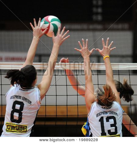 KAPOSVAR, HUNGARY - OCTOBER 10: Dora Kornyei (L) in action at the Hungarian NB I. League woman volleyball game Kaposvar vs Veszprem, October 10, 2010 in Kaposvar, Hungary.
