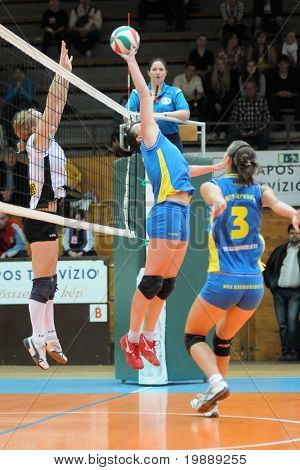 KAPOSVAR, HUNGARY - OCTOBER 10: Marianna Palfy (2nd from R) in action at the Hungarian NB I. League woman volleyball game Kaposvar vs Veszprem, October 10, 2010 in Kaposvar, Hungary.