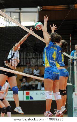 KAPOSVAR, HUNGARY - OCTOBER 10: Horvath (4) and Harmath (3) blocks the ball at the Hungarian NB I. League woman volleyball game Kaposvar vs Veszprem, October 10, 2010 in Kaposvar, Hungary.