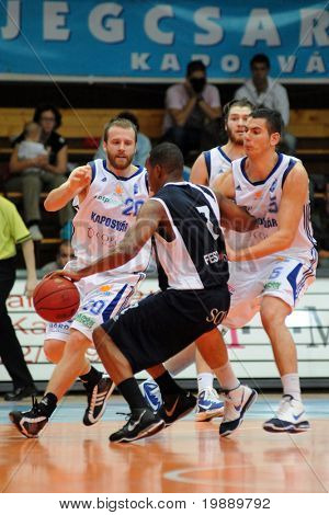 KAPOSVAR, HUNGARY - OCTOBER 24: Joshua Wilson (20) in action at a Hugarian Champonship basketball game Kaposvar vs. Szeged October 24, 2010 in Kaposvar, Hungary.
