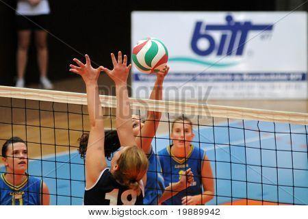 KAPOSVAR, HUNGARY - OCTOBER 31: Barbara Balajcza (2 nd from R) strikes the ball at the Hungarian NB I. League woman volleyball game Kaposvar vs Ujbuda, October 31, 2010 in Kaposvar, Hungary.