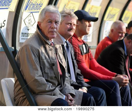 KAPOSVAR, HUNGARY - NOVEMBER 6: Gyorgy Mezey (L) (Videoton trainer) at a Hungarian National Championship soccer game Kaposvar vs Videoton FC November 6, 2010 in Kaposvar, Hungary.