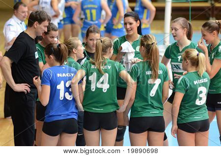 KAPOSVAR, HUNGARY - NOVEMBER 14: Miskolc players listen to their trainer at the Hungarian NB I. League woman volleyball game Kaposvar vs Miskolc on November 14, 2010 in Kaposvar, Hungary.