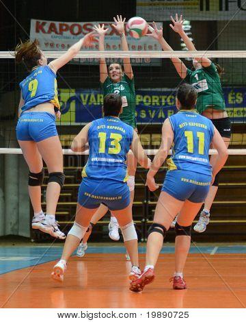 KAPOSVAR, HUNGARY - NOVEMBER 14: Rebeka Rak (L) strikes the ball at the Hungarian NB I. League woman volleyball game Kaposvar vs Miskolc on November 14, 2010 in Kaposvar, Hungary.
