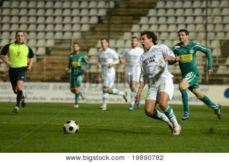 KAPOSVAR, HUNGARY - NOVEMBER 19: Jawad Daniane (2nd from R) in action at a Hungarian National Championship soccer game Kaposvar vs Gyori ETO November 19, 2010 in Kaposvar, Hungary.