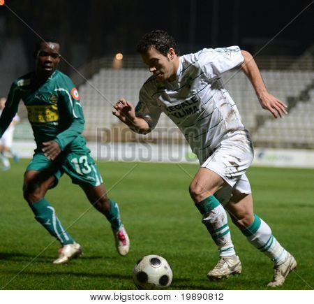 KAPOSVAR, HUNGARY - NOVEMBER 19: Boris Gujic (R) in action at a Hungarian National Championship soccer game Kaposvar vs Gyori ETO November 19, 2010 in Kaposvar, Hungary.