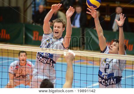 KAPOSVAR, HUNGARY - NOVEMBER 25: Krisztian Csoma (L) blocks the ball at the CEV Cup volleyball game Kaposvar (HUN) vs Resovia Rzeszov (POL), November 25, 2010 in Kaposvar, Hungary