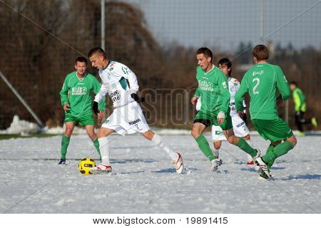 KAPOSVAR, HUNGARY - NOVEMBER 27: Patrik Bojte (2 nd from L) in action at the Hungarian National Championship under 19 game between Kaposvar and Illes Academy November 27, 2010 in Kaposvar, Hungary.