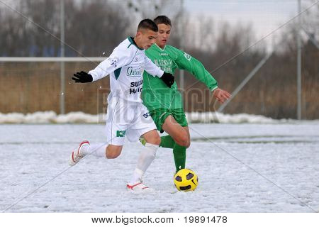KAPOSVAR, HUNGARY - NOVEMBER 27: Patrik Bojte (L) in action at the Hungarian National Championship under 19 game between Kaposvar and Illes Academy November 27, 2010 in Kaposvar, Hungary.