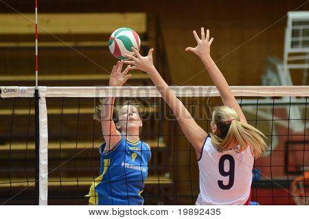 KAPOSVAR, HUNGARY - DECEMBER 12: Rebeka Rak (L) in action at the Hungarian NB I. League woman volleyball game Kaposvar vs Eger on December 12, 2010 in Kaposvar, Hungary.