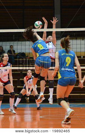 KAPOSVAR, HUNGARY - DECEMBER 12: Barbara Balajcza (8) in action at the Hungarian NB I. League woman volleyball game Kaposvar vs Eger on December 12, 2010 in Kaposvar, Hungary.